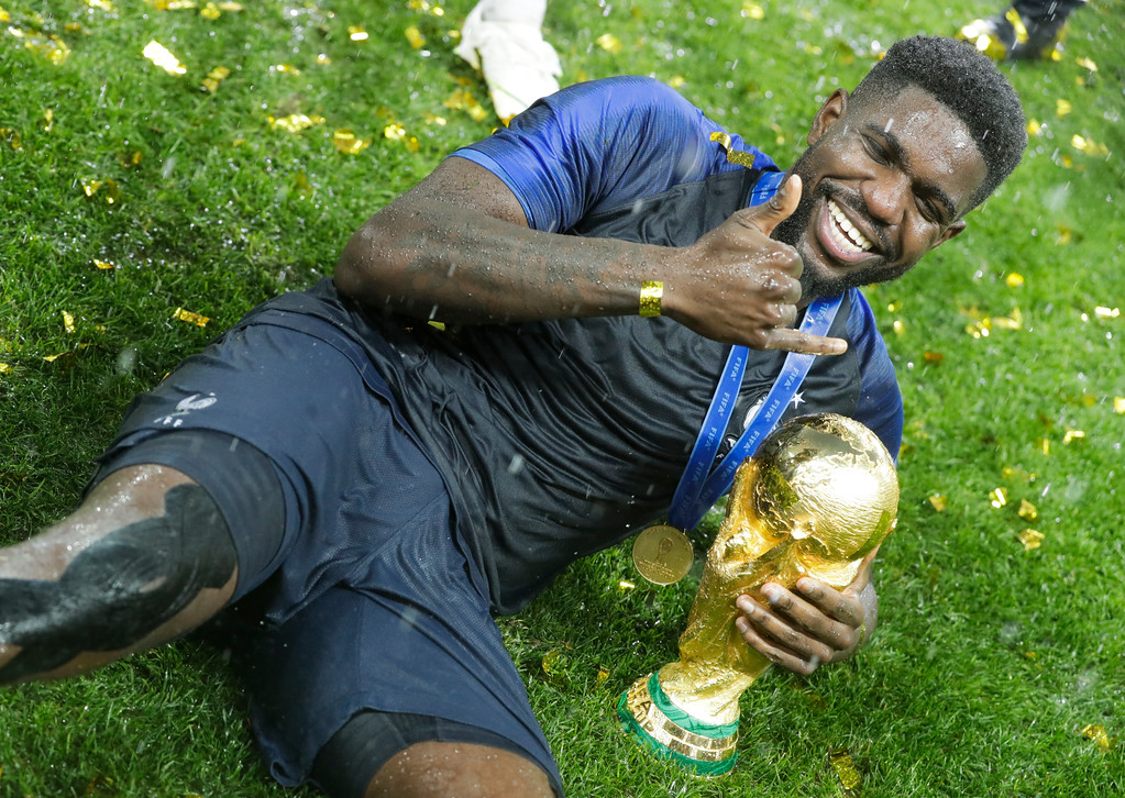 . France\'s Samuel Umtiti celebrates with the trophy at the end of the final match between France and Croatia at the 2018 soccer World Cup in the Luzhniki Stadium in Moscow, Russia, Sunday, July 15, 2018. (AP Photo/Matthias Schrader)