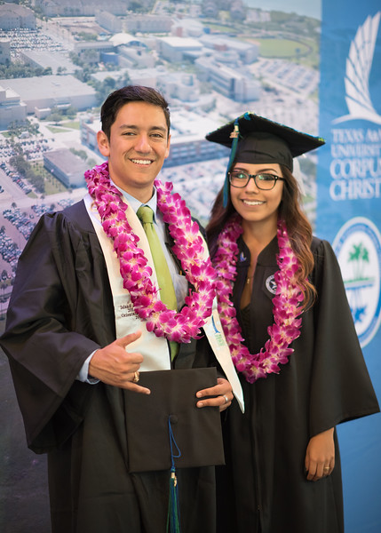 Zach Baltazar (left) and Samantha Garcia. Over 1,100 graduates received their degrees during two commencement ceremonies held on May 13.