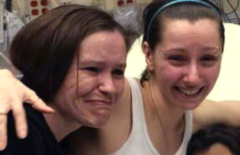 . Amanda Berry, right, hugs her sister Beth Serrano after being reunited in a Cleveland hospital Monday May 6, 2013. Berry and two other women were found in a house near downtown Cleveland Monday after being missing for about a decade. (AP Photo/Family Handout courtesy WOIO-TV)