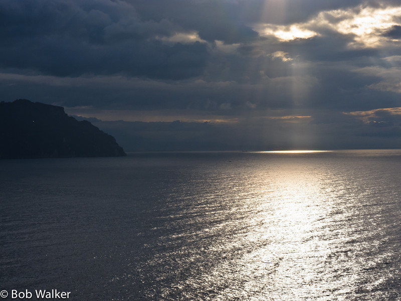 After a rainy drive to our hotel in Amalfi city, we woke up to cloudy skies the next day. Fortunately, Michele caught sunlight peeping through the clouds onto the water