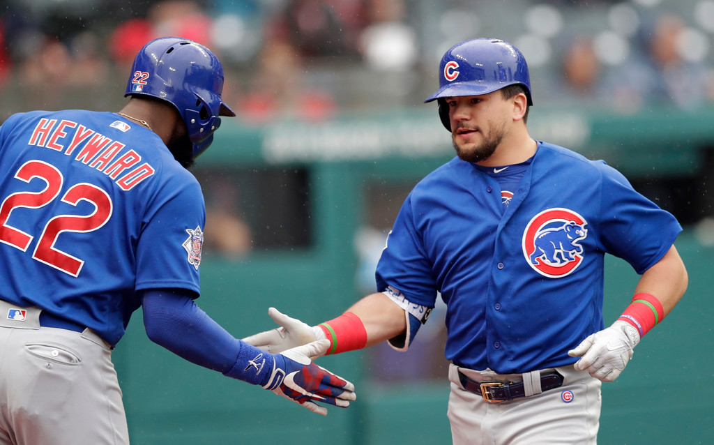 . Chicago Cubs\' Kyle Schwarber, right, is congratulated by Jason Heyward after Schwarber hit a solo home run off Cleveland Indians starting pitcher Josh Tomlin in the second inning of a baseball game, Tuesday, April 24, 2018, in Cleveland. (AP Photo/Tony Dejak)