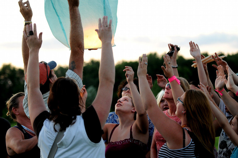 . Candy Zappa, center, of Centuria helped launch a sky lantern in dedication to Isaiah during a candlelight vigil. (Pioneer Press: Jean Pieri)