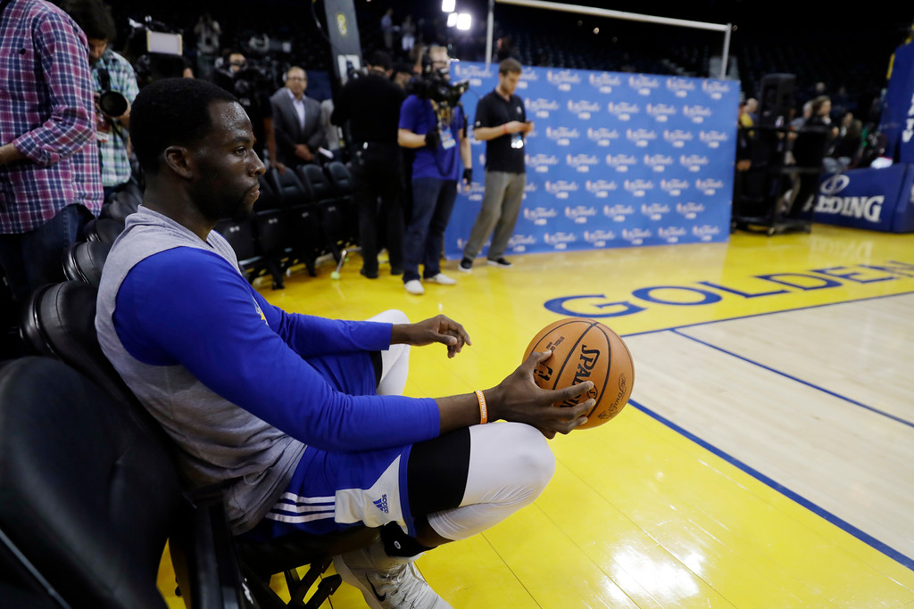 . Golden State Warriors\' Draymond Green watches from a fan seat during an NBA basketball practice, Wednesday, May 31, 2017, in Oakland, Calif. The Golden State Warriors face the Cleveland Cavaliers in Game 1 of the NBA Finals on Thursday in Oakland. (AP Photo/Marcio Jose Sanchez)