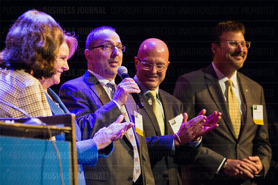 Outstanding Voices recipient Joe Adams, CEO of 1st Security Bank, speaks as other Outstanding Voices honorees listen during the Puget Sound Business Journal's The Business Of Pride at the Paramount Theatre in Seattle on Thursday, May 26, 2016. (BUSINESS JOURNAL PHOTO | Dan DeLong)