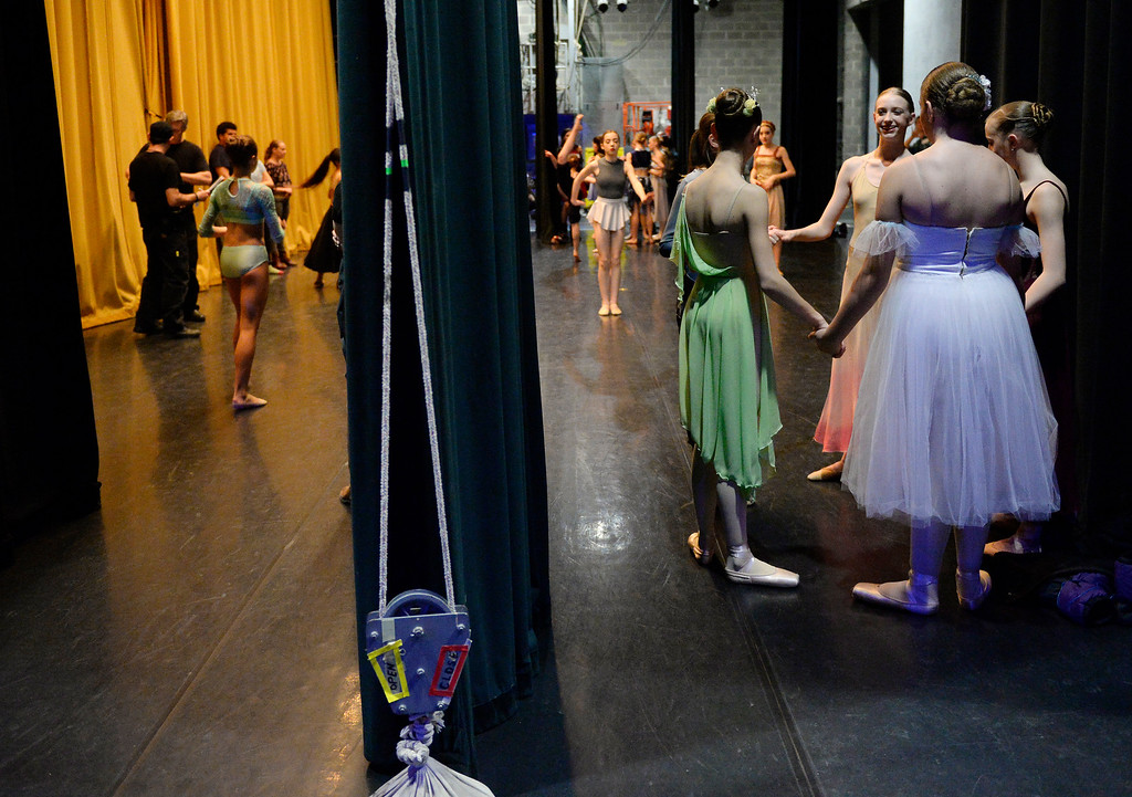 . Hundreds of ballet dancers came to The Theater at Colorado Heights University in Denver to compete in the Youth America Grand Prix Regional semi-finals on Friday, February 19, 2016.  Before competing in the junior contemporary category these dancers hold hands in a moment of support before the curtain went up. The weekend competition was for dancers to earn scholarships and invitations to prestigious dance companies.    (Photo by Cyrus McCrimmon/ The Denver Post)