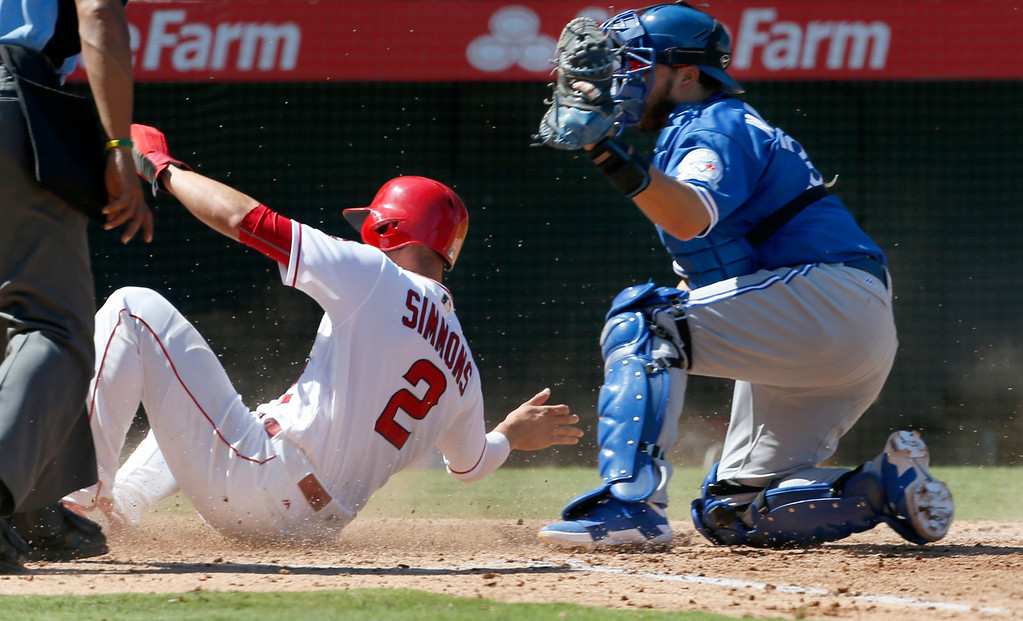 . Toronto Blue Jays catcher Dioner Navarro gets Los Angeles\' Andrelton Simmons out a home in the fourth inning of a baseball game in Anaheim, Calif., Sunday, Sept. 18, 2016. (AP Photo/Christine Cotter)