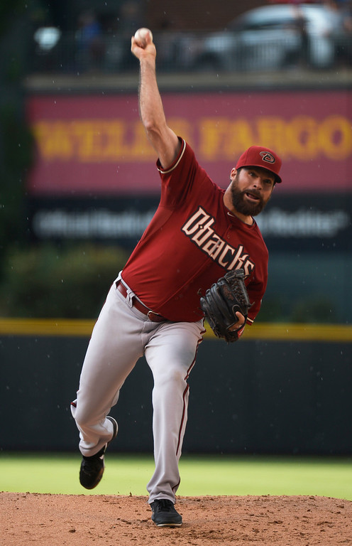 . Arizona Diamondbacks starting pitcher Josh Collmenter (55) delivers a pitch during the first inning against the Colorado Rockies June 4, 2014 at Coors Field. (Photo by John Leyba/The Denver Post)