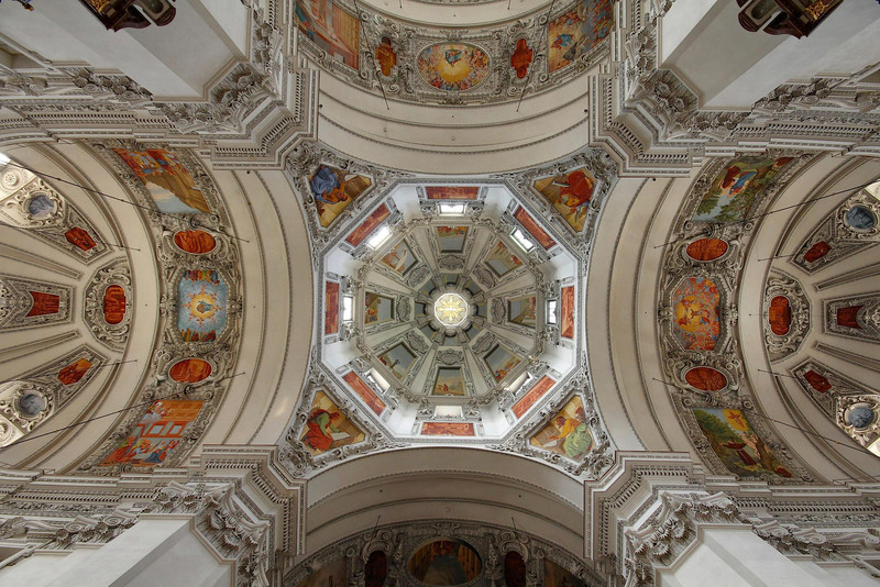 The amazing Salzburg Cathedral in Salzburg, Austria. Built in 1628, the huge church is 466 feet long. A single WWII bomb fell right through the central dome, pictured. That damage was not fully repaired until 1959 .