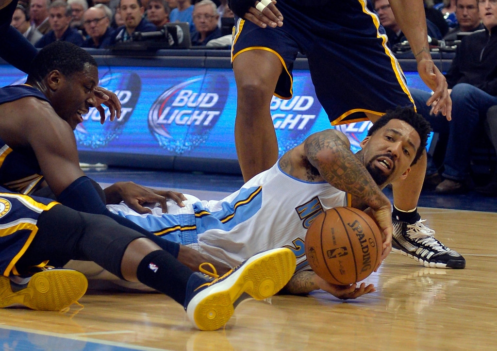 . Denver Nuggets small forward Wilson Chandler grabs a loose ball against the Indiana Pacers during the third quarter of an NBA basketball game Saturday, Jan. 25, 2014, in Denver. (AP Photo/Jack Dempsey)