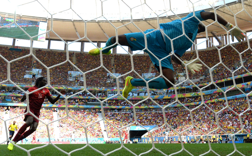 . Ghana\'s goalkeeper Fatau Dauda dives for the ball during the Group G football match between Portugal and Ghana at the Mane Garrincha National Stadium in Brasilia during the 2014 FIFA World Cup on June 26, 2014.  (CARL DE SOUZA/AFP/Getty Images)