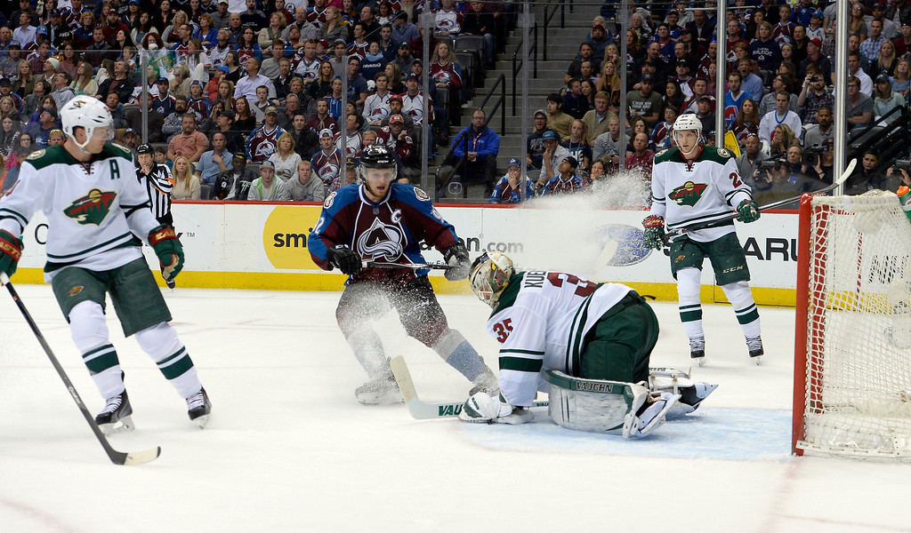 . DENVER, CO - APRIL 26: Colorado Avalanche left wing Gabriel Landeskog (92) sprays Minnesota Wild goalie Darcy Kuemper (35) and gets an unsportsman like conduct penalty during the third period of action. The Colorado Avalanche hosted the Minnesota Wild in the fifth round of the Stanley Cup Playoffs at the Pepsi Center in Denver, Colorado on Saturday, April 26, 2014. (Photo by John Leyba/The Denver Post)