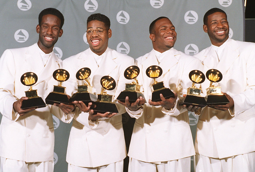 ". Boyz II Men, shown in this March 1, 1995 photo, display their Grammy awards for Best R&B Album and for Best R&B Duo or Vocal Performance. From left are Shawn Stockman, Nate Morris, Wanya Morris and Michael S. McCary. Along with Mariah Carey the group was nominated Thursday, Jan. 4, 1996, for a Grammy for ""One Sweet Day\"" as the record of the year. Winners will be announced Feb. 27. (AP Photo/Mark J. Terrill)"