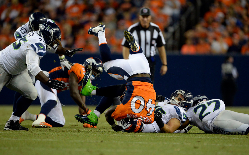 . Running back Juwan Thompson (40) of the Denver Broncos gets taken down by linebacker Brock Coyle (45) of the Seattle Seahawks during the first half.  The Denver Broncos vs the Seattle Seahawks At Sports Authority Field at Mile High. (Photo by AAron Ontiveroz/The Denver Post)