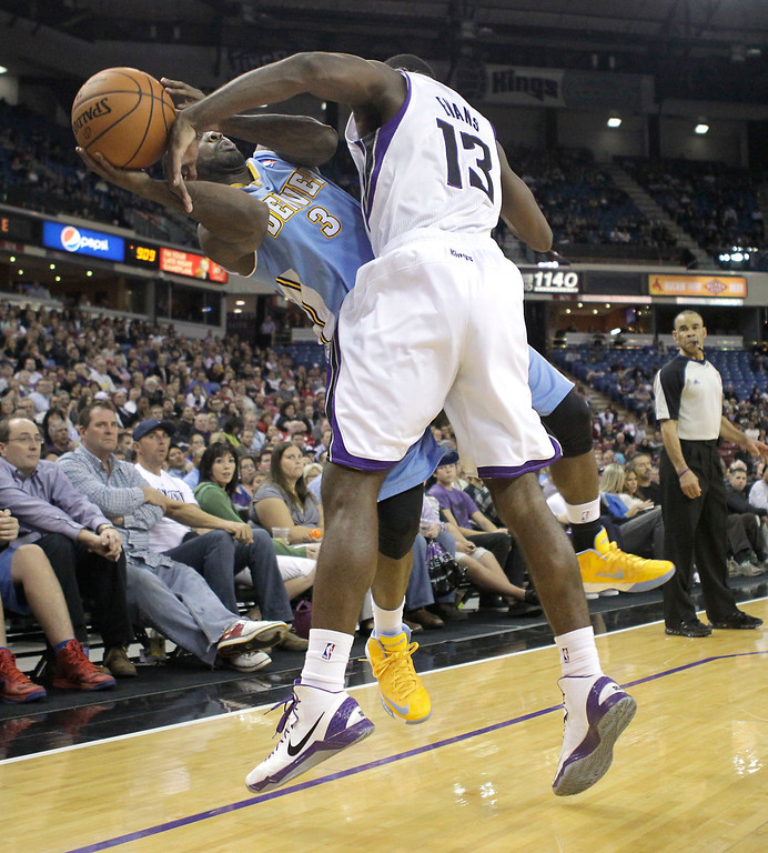 . Denver Nuggets guard Ty Lawson, left, is fouled by  Sacramento Kings guard Tyreke Evans  during the fourth quarter of an NBA basketball game in Sacramento, Calif., Tuesday, March 5, 2013.  The Nuggets won 120-113.(AP Photo/Rich Pedroncelli)