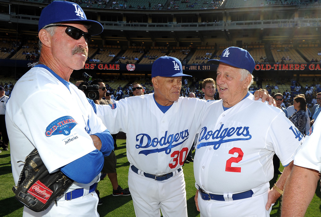 . Former Los Angeles Dodgers manager Tommy Lasorda, right, with Maury Wills (30) and Bill Buckner (22) during the Old-Timers game prior to a baseball game between the Atlanta Braves and the Los Angeles Dodgers on Saturday, June 8, 2013 in Los Angeles. 