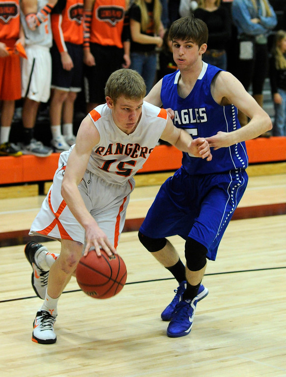 . Rangers guard Dylan Tucker (15) worked past Eagles\' senior Tarren Macrae (5) in the second half. The Lewis-Palmer High School boy\'s basketball team defeated Broomfield 75-53 Friday night, December 7, 2012.  Karl Gehring/The Denver Post