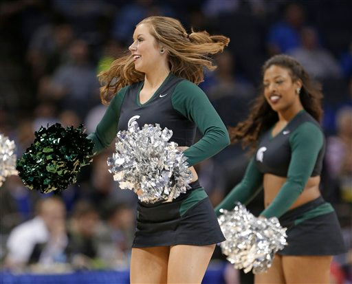 . Michigan State cheerleaders perform during the first half of an NCAA tournament college basketball game against Virginia in the Round of 32 in Charlotte, N.C., Sunday, March 22, 2015. (AP Photo/Gerald Herbert)