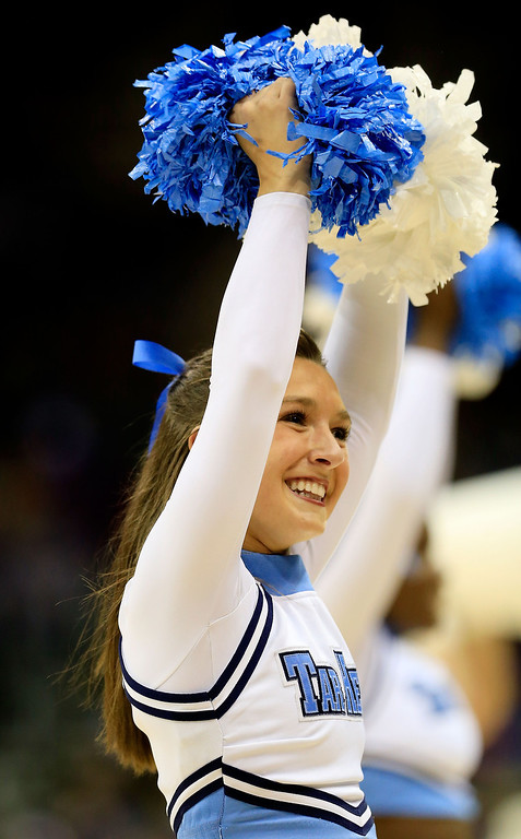 . KANSAS CITY, MO - MARCH 22: A North Carolina Tar Heels cheerleader performs in the first half of the game against the Villanova Wildcats during the second round of the 2013 NCAA Men\'s Basketball Tournament at the Sprint Center on March 22, 2013 in Kansas City, Missouri.  (Photo by Jamie Squire/Getty Images)
