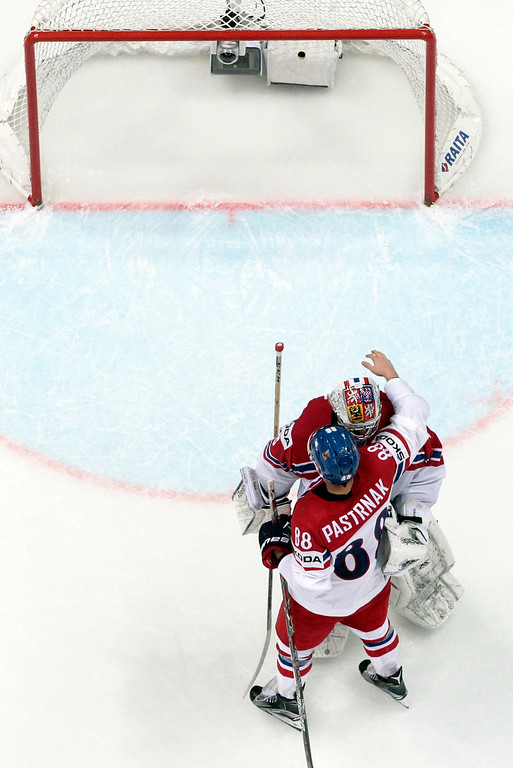 . Czech Republicís David Pastrnak, bottom, celebrate with goalie Dominik Furch as they won the Ice Hockey World Championships Group A match between Czech Republic and Norway in Moscow, Russia, on Thursday, May 12, 2016. (AP Photo/Pavel Golovkin)