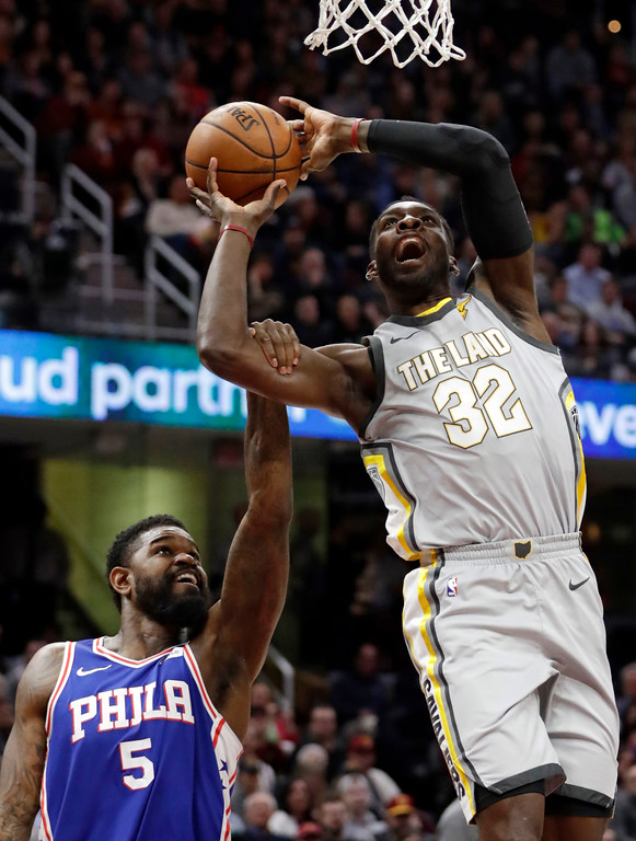 . Cleveland Cavaliers\' Jeff Green (32) is fouled by Philadelphia 76ers\' Amir Johnson (5) in the first half of an NBA basketball game, Thursday, March 1, 2018, in Cleveland. (AP Photo/Tony Dejak)