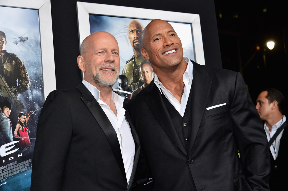 ". Actors Bruce Willis and Dwayne ""The Rock\"" Johnson attend the premiere of Paramount Pictures\' \""G.I. Joe: Retaliation\"" at TCL Chinese Theatre on March 28, 2013 in Hollywood, California.  (Photo by Alberto E. Rodriguez/Getty Images)"