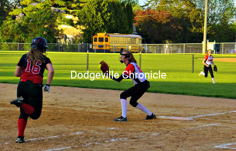 Olivia Argall receives the throw at first - Zoie Weber backs up the play.jpg