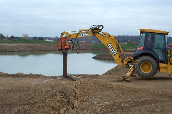 NPK C6C compactor on Deere backhoe-pile driving (26).jpg