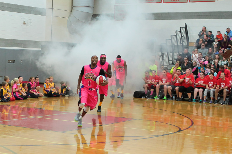 The Harlem Wizards arrive in a cloud of smoke last Monday for the Kingston PTO fundraiser. Wicked Local Photo/Denise Maccaferri