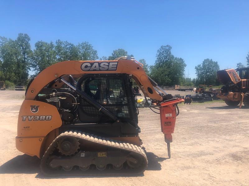 NPK PH2 hydraulic hammer on Case CTL skid steer - Monroe Tractor  06-20 (1).jpg