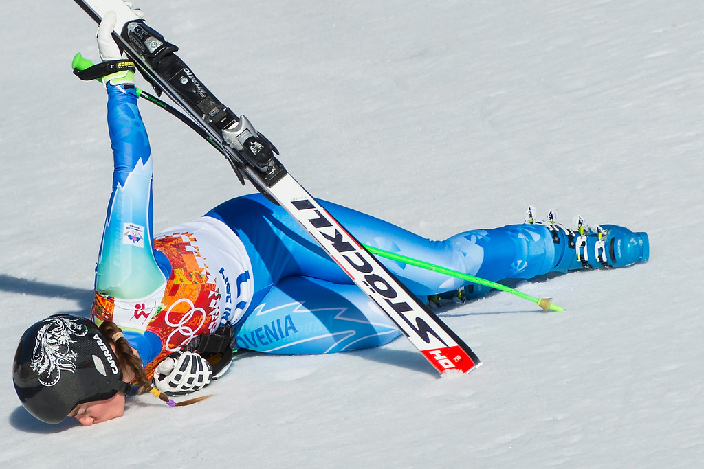 . Tina Maze of Slovenia kisses the snow in the finish area after her run in the Women\'s Downhill race at the Rosa Khutor Alpine Center during the Sochi 2014 Olympic Games, Krasnaya Polyana, Russia, 12 February 2014.  EPA/JEAN-CHRISTOPHE BOTT