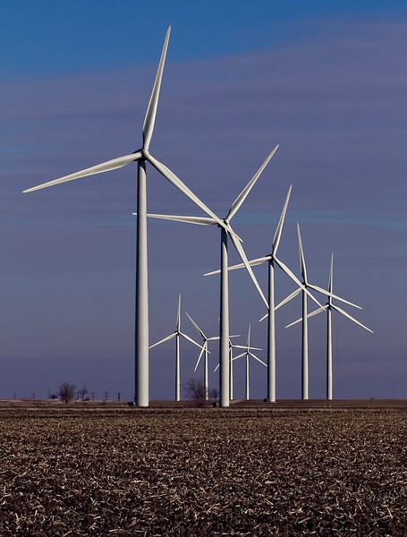 Field of wind turbines near Dekalb IL generating clean electricity and a second income for farmers.