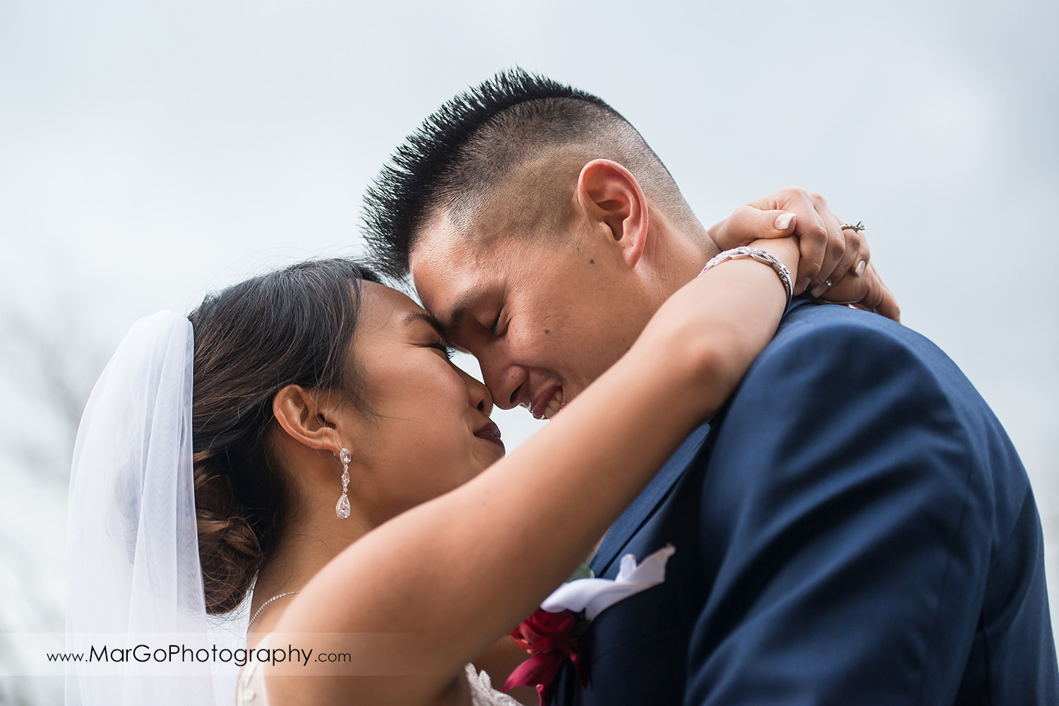 bride and groom touching foreheads at train station near Sunol's Casa Bella