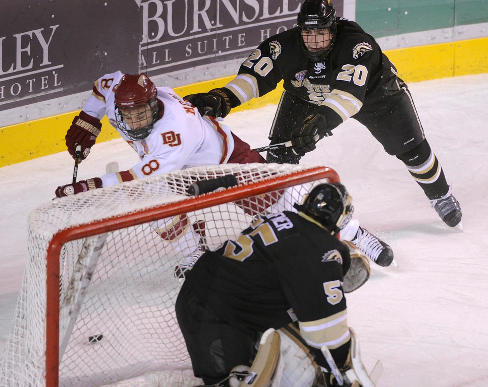 . DENVER, CO. - NOVEMBER 16: Denver left wing Trevor Moore (8) worked behind the net in the first period. The University of Denver hockey team hosted Western Michigan at Magness Arena Saturday night, November 16, 2013.  Photo By Karl Gehring/The Denver Post