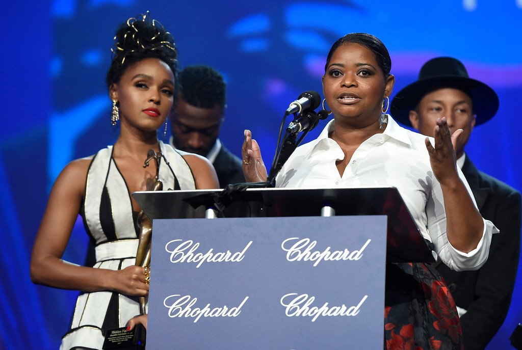 ". Octavia Spencer accepts the ensemble performance award for ""Hidden Figures\"" at the 28th annual Palm Springs International Film Festival Awards Gala on Monday, Jan. 2, 2017, in Palm Springs, Calif. Looking on from left are Janelle Monae, and in background Aldis Hodge, and Pharrell Williams. (Photo by Chris Pizzello/Invision/AP)"