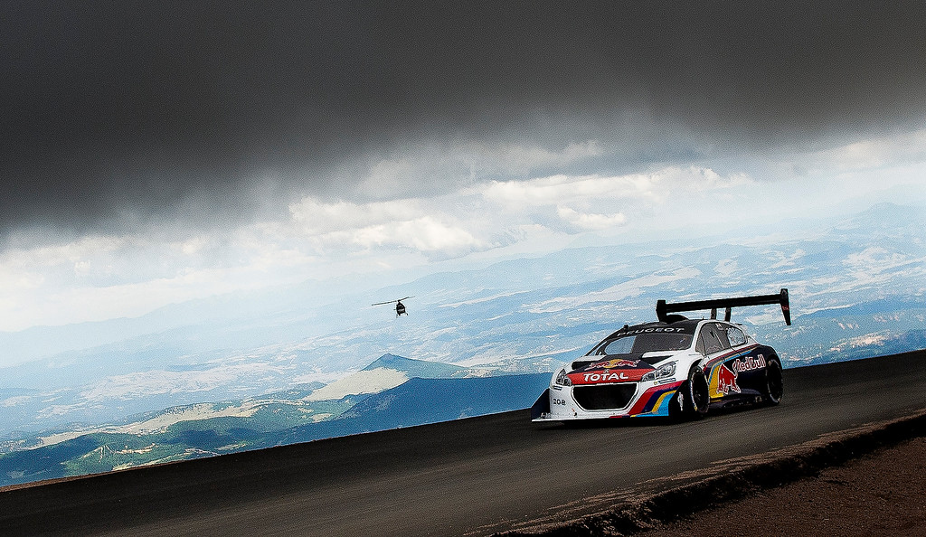 . Sebastein Loeb approaches the finish line to complete his record-setting run of the Pikes Peak International Hill Climb Sunday, June 30, 2013. Loeb shattered the former course record with a time of 8 minutes 13 seconds. (Michael Ciaglo, The Gazette)