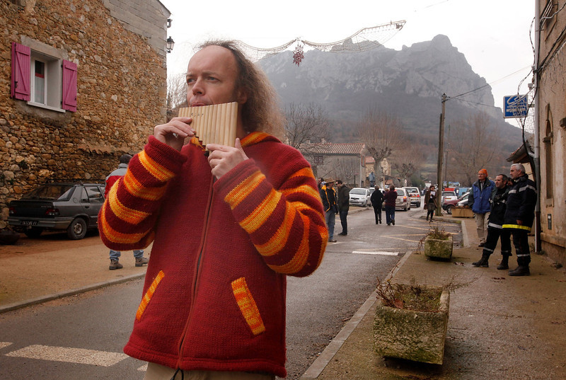 . A man plays some pipes after the time passed 11.11 am, the time the Mayan Apocalypse was supposed to occur in Bugarach village on December 21, 2012 in Bugarach, France. The prophecy of an ancient Mayan calendar claimed that today would see the end of the world, and that Burgarach is the only place on Earth which will be saved from the apocalypse. (Photo by Patrick Aventurier/Getty Images)