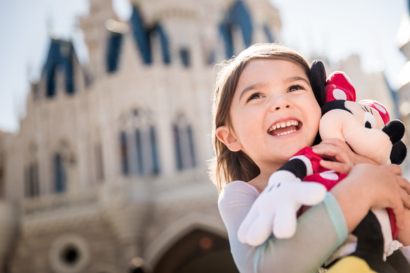 Little-Girl-Excited-Hugging-Minnie-Mouse-Doll.jpg
