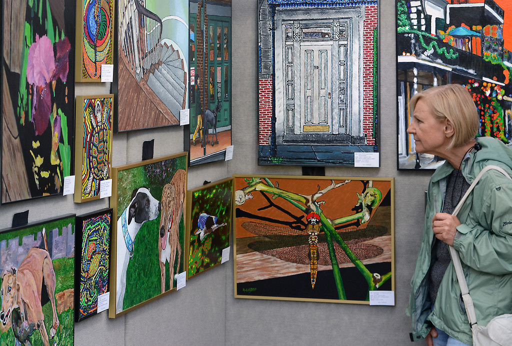. Works by artist Mark V Turner are inspected during the 26th Annual Lansdale Festival of the Arts in Memorial Park on Saturday August 23,2014. Photo by Mark C Psoras/The Reporter