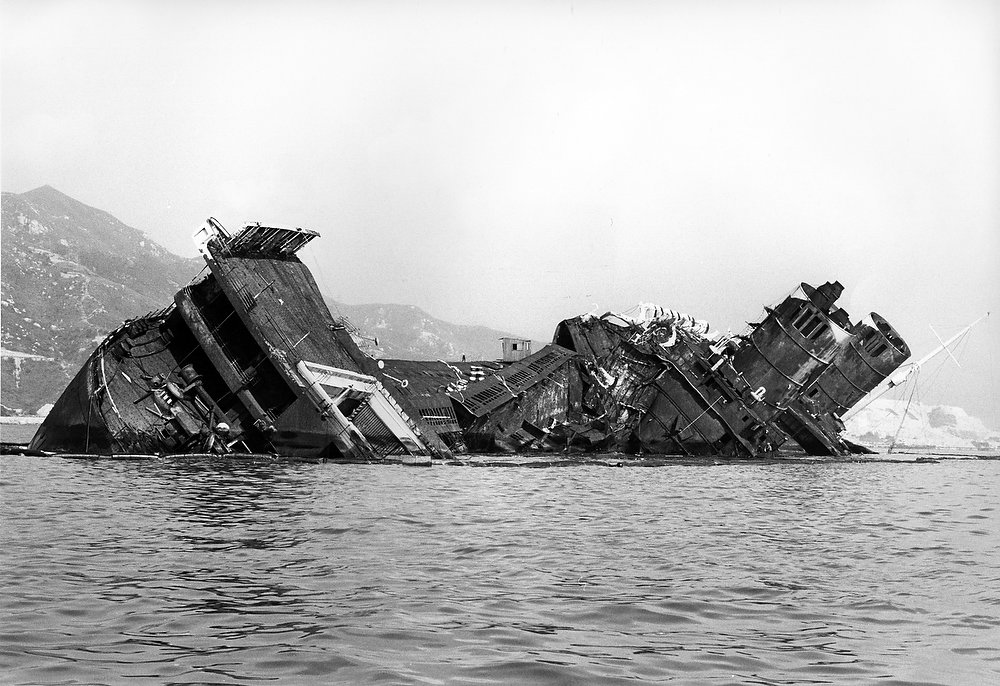 Description of . The severity of the damage of the wreck of the Queen Elizabeth is seen in Hong Kong harbor onOct. 27, 1972. The steel plating which has a grill or ribbed appearance was the side of the liner. The heat of the fire was so intense it folded over through more than 90 degrees. On top of the stern is a swimming pool.
