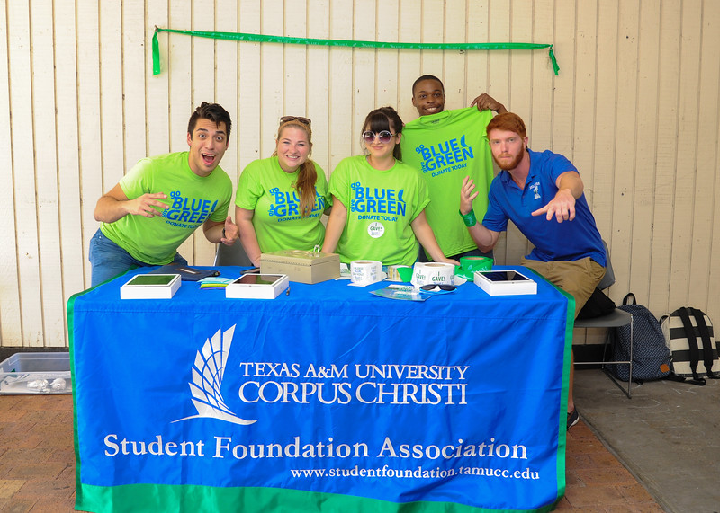 The Student Foundation Association shows off their Go Blue Give Green campaign.