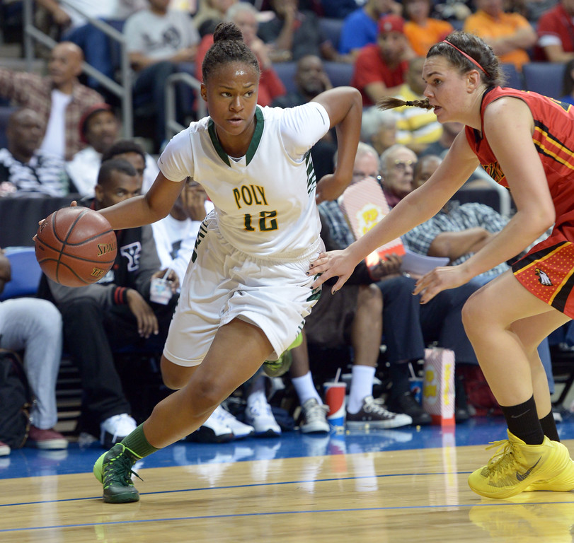 . Poly\'s Arica Camron drives to the basket at Citizens Business Bank Arena in Ontario, CA on Saturday, March 22, 2014. Long Beach Poly vs Etiwanda in the CIF girls open division regional final. 1st half, Photo by Scott Varley, Daily Breeze)