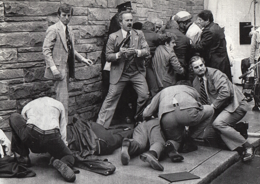 . 3/30/81 - Washington: This was the scene outside the Washington Hilton Hotel on March 30, 1981. Secret Service agents tend to policeman Thomas Delahanty (l) and press secretary James Brady while other agents and policemen in the background seize assailant John W. Hinckley Jr.  President Reagan and agent  Timothy McCarthy also were wounded.   (Los Angeles Daily News file photo)