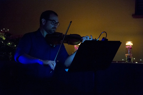 10/02/19 Wesley Bunnell | StaffrrThe Prudence Crandall Center held a candlelight vigil in remembrance of victims of domestic violence on Wednesday night. A violinist plays as names of victims of domestic violence are read aloud.