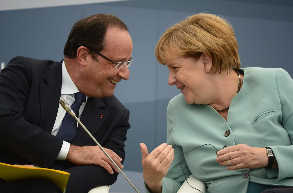 . Frances President Francois Hollande (L) smiles while talking to Germanys Chancellor Angela Merkel as they attend a meeting with Business 20 and Labour 20 representatives during the G20 summit on September 6, 2013 in Saint Petersburg. ERIC FEFERBERG/AFP/Getty Images