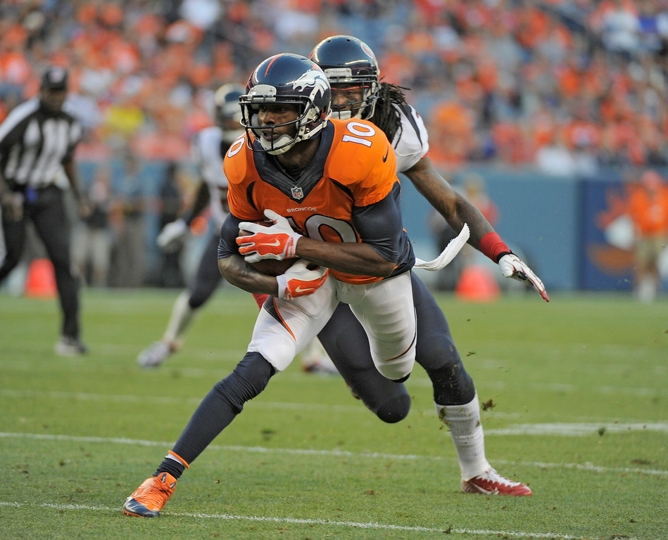 . DENVER, CO - AUGUST 23: Denver Broncos wide receiver Emmanuel Sanders (10) turns up field after a catch during the first quarter against the Houston Texans August 23, 2014 at Sports Authority Field at Mile High Stadium. (Photo by John Leyba/The Denver Post)