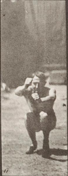 Man in pelvis cloth jumping, standing broad jump