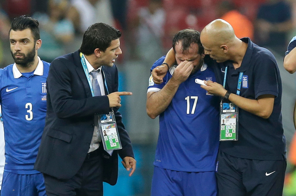 . Greece\'s Fanis Gekas, center, is consoled by his teammates after a penalty shootout at the end of the World Cup round of 16 soccer match between Costa Rica and Greece at the Arena Pernambuco in Recife, Brazil, Sunday, June 29, 2014. Costa Rica won 5-3 on penalties after the match ended 1-1.  (AP Photo/Andrew Medichini)