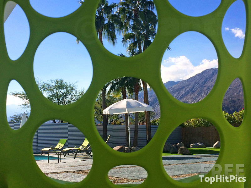 A Retro Lime Green Seat Overlooking a Palm Springs Pool in California