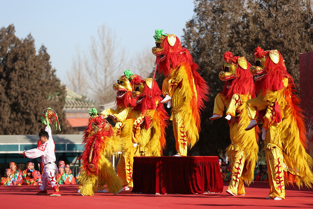 . Chinese folk artists perform during the Spring Festival Temple Fair at the Temple of Earth park on January 30, 2014 in Beijing, China.  (Photo by Feng Li/Getty Images)