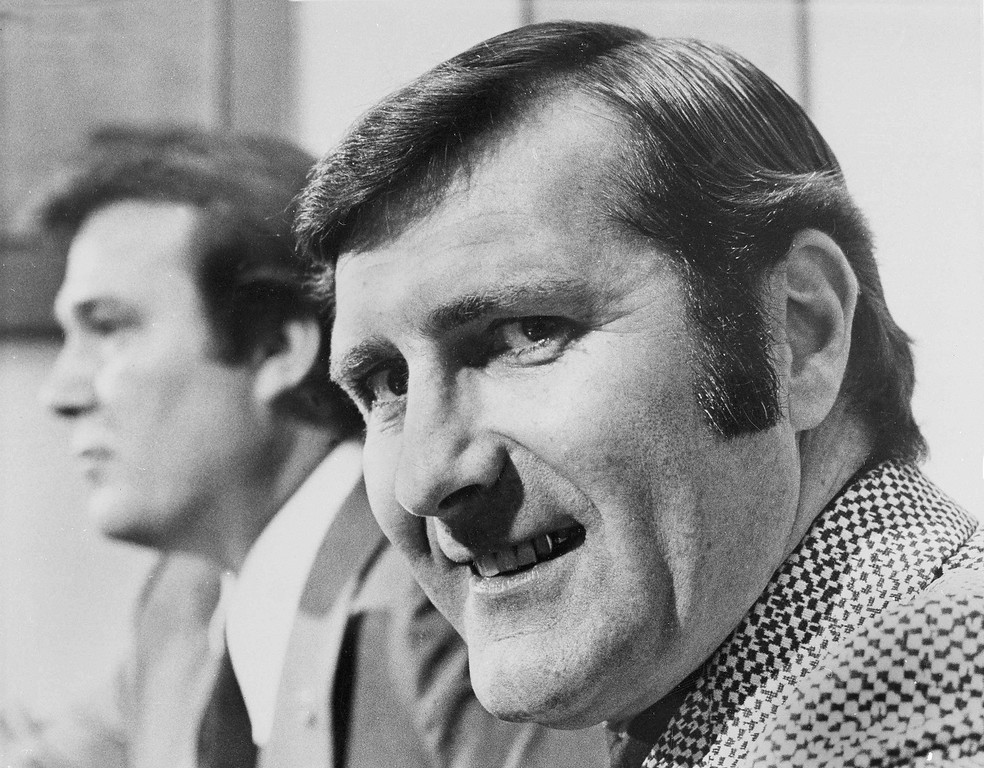 . Retired astronaut Richard Gordon smiles during a press conference after he was named executive vice president of the New Orleans Saints, in New Orleans, La., Jan.7, 1972. in the background is Saints owner John Mecom Jr. Gordon died Nov. 6 at age 88. (AP Photo)